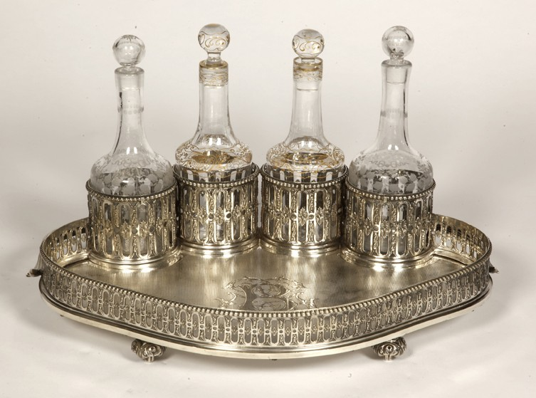 Goldsmith ODIOT - Cabaret in sterling silver and 4 19th century crystal bottles